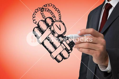 Composite image of businessman drawing dynamite