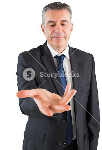 Mature businessman standing with hand out