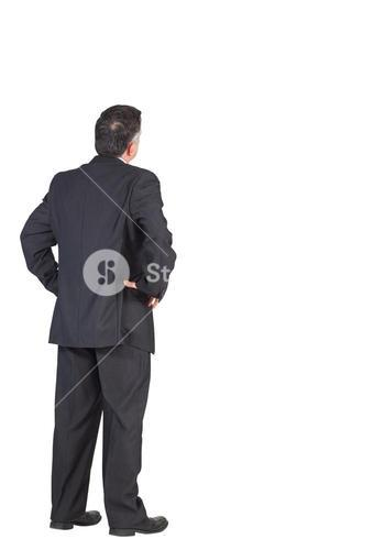 Mature businessman standing with hands on hips