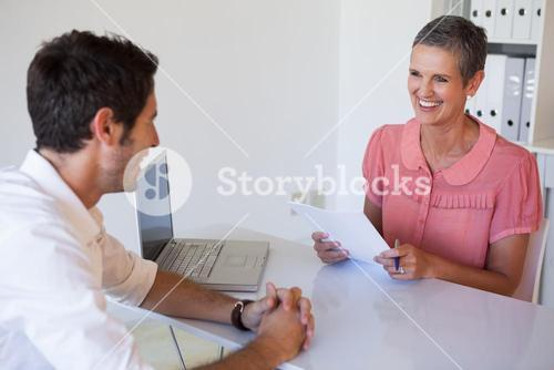 Casual business people having a meeting at desk