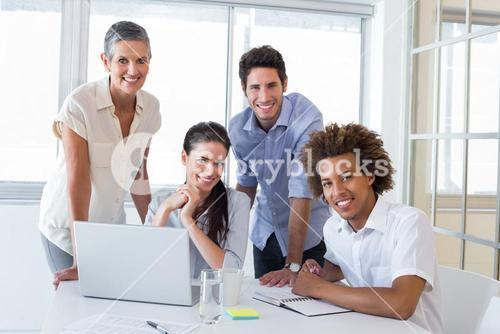 Business people smiling to camera