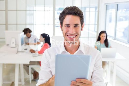 Businessman working on tablet pc