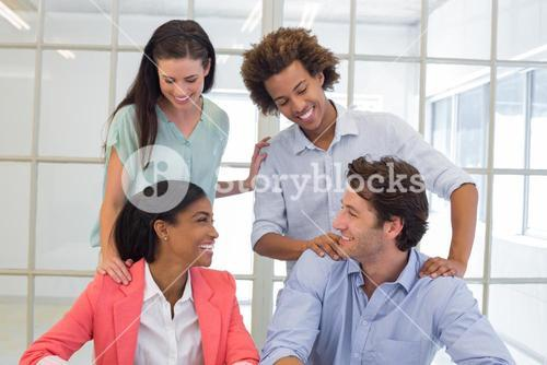 Coworkers congratulating and praising each other