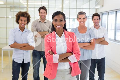 Businesswoman and coworkers smiling at camera