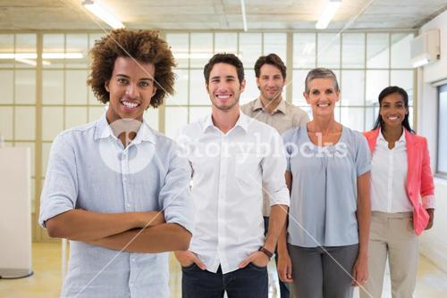 Group of business people being cheerful and smiling at camera