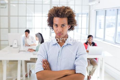 Stern worker with arms crossed