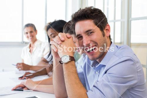 Casual businessman laughing during meeting