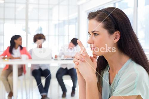 Attractive businesswoman concentrating and focusing
