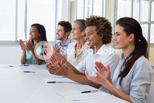 Casual business team clapping at presentation