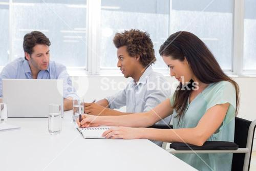 Attractive casual business people at meeting