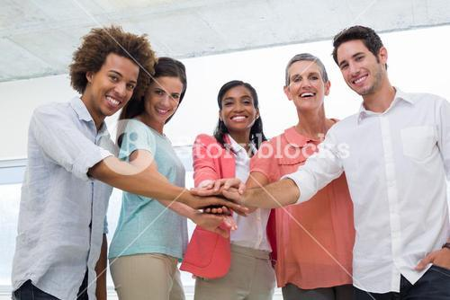 Attractive business people uniting at work