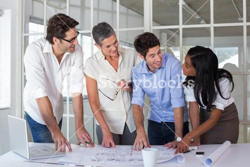 Team of architects going over blueprints