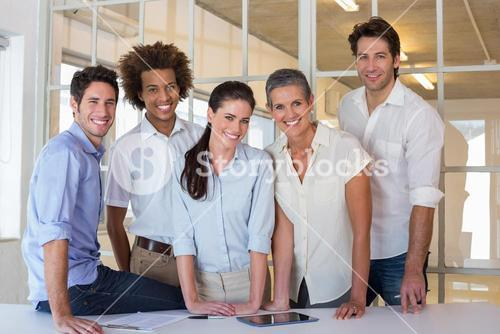 Casual group of coworker friends smiling