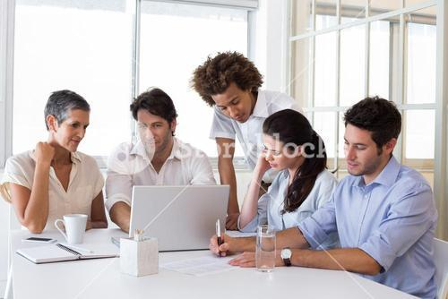 Attractive business people working hard on plans