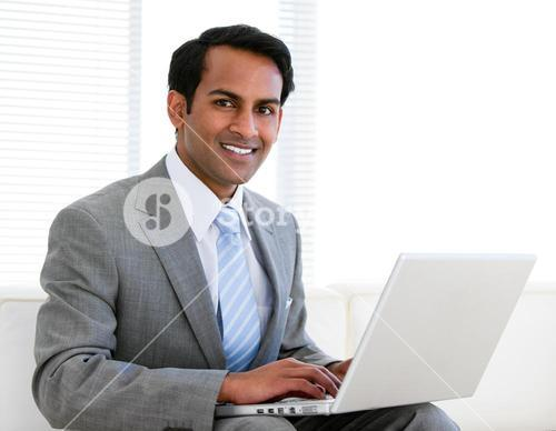 Confident businessman working on his computer