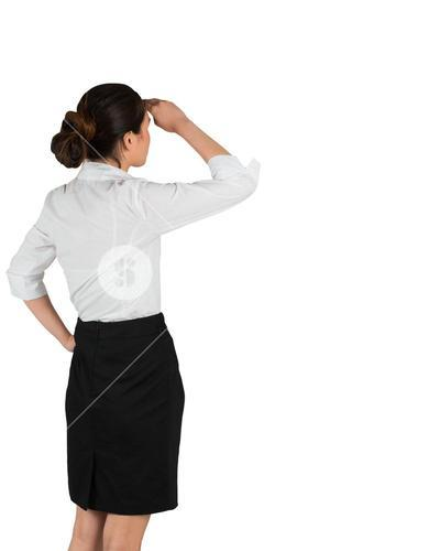 Businesswoman in white shirt looking ahead