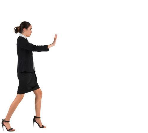 Businesswoman in suit standing and pushing