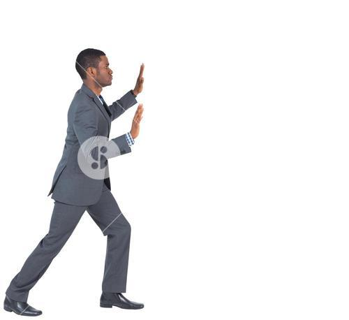 Businessman standing and pushing with hands