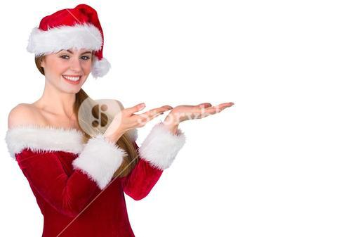 Pretty redhead in santa outfit presenting with hands