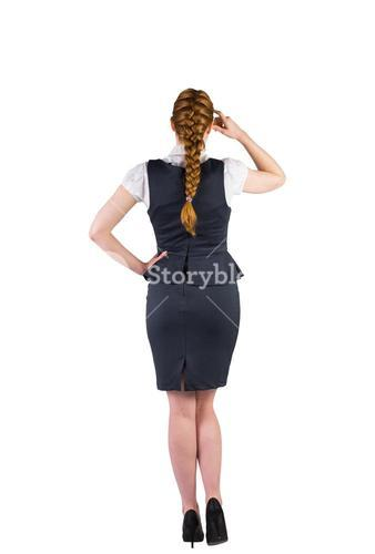 Redhead businesswoman scratching her head