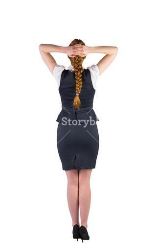 Redhead businesswoman standing with hands on head