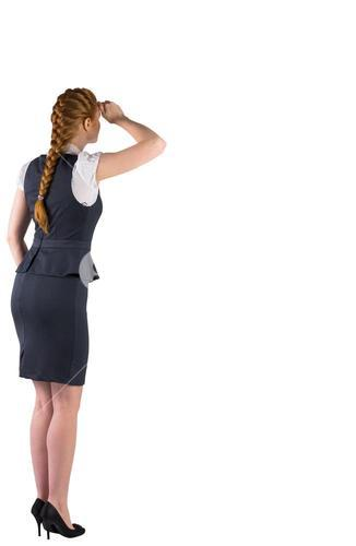 Redhead businesswoman standing and looking