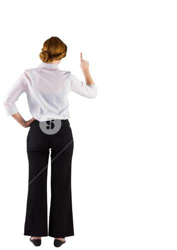 Redhead businesswoman standing and pointing