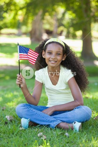 Young girl celebrating independence day in the park