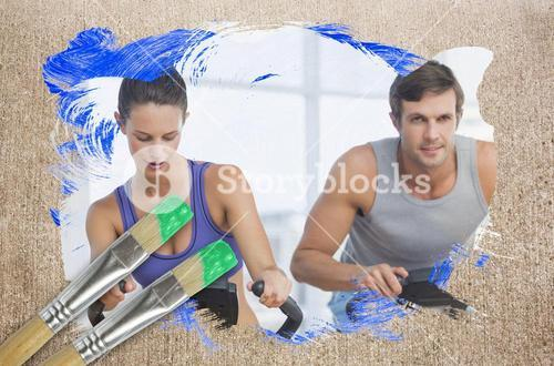 Composite image of couple working out in gym