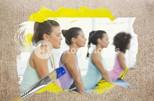 Composite image of yoga class in the gym