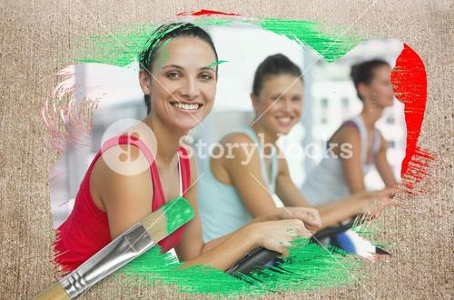 Composite image of spinning class in the gym