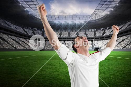 Excited football fan cheering