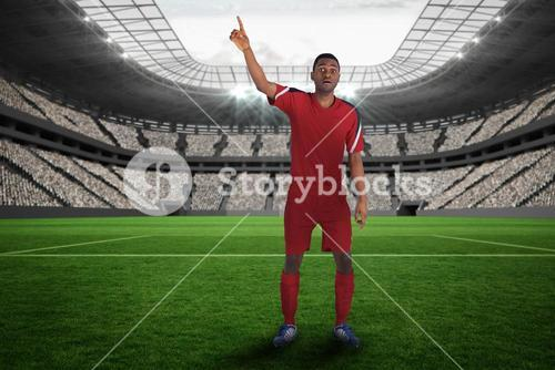 Football player in red raising his hand