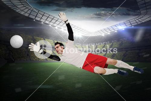 Goalkeeper in white making a save
