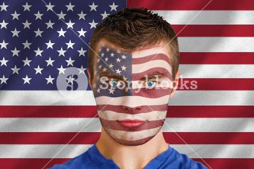 Serious young usa fan with facepaint