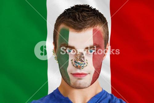 Serious young mexico fan with facepaint