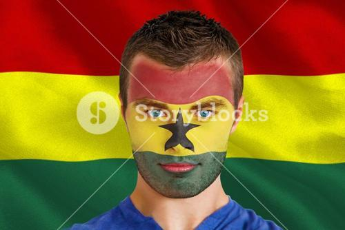 Serious young ghana fan with facepaint