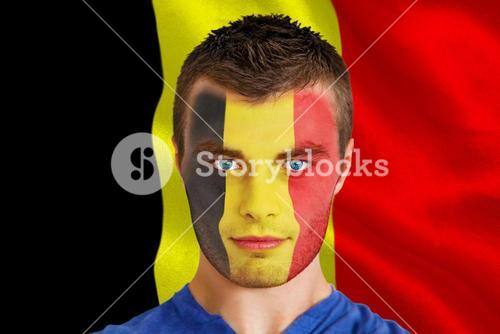 Serious young belgium fan with facepaint