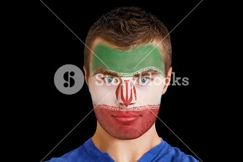 Serious young iran fan with facepaint