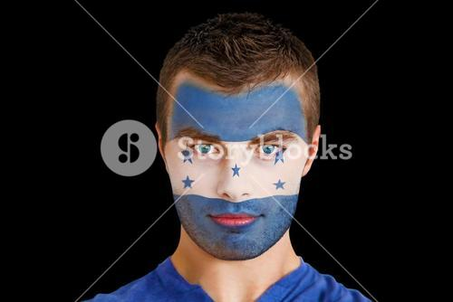 Serious young honduras fan with facepaint