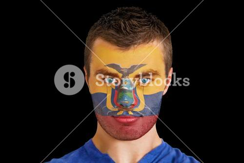 Serious young ecuador fan with facepaint