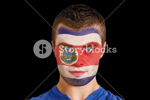 Serious young costa rica fan with facepaint