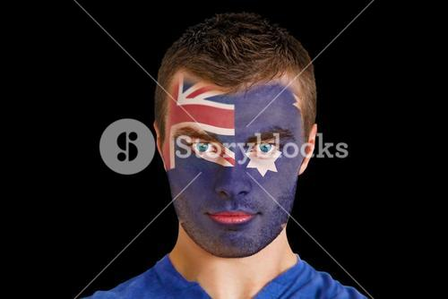 Serious young australia fan with facepaint