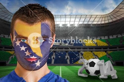 Serious young bosnia fan with face paint