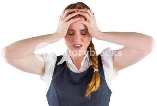 Stressed businesswoman with hands on head