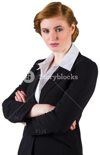 Stylish redhead businesswoman in suit