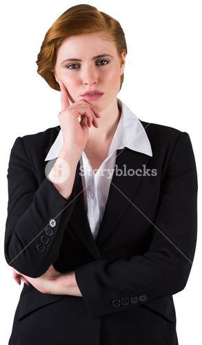Thinking redhead businesswoman in suit