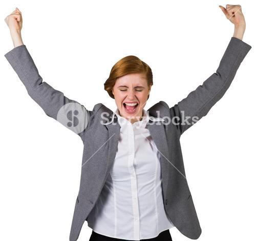 Excited redhead businesswoman cheering