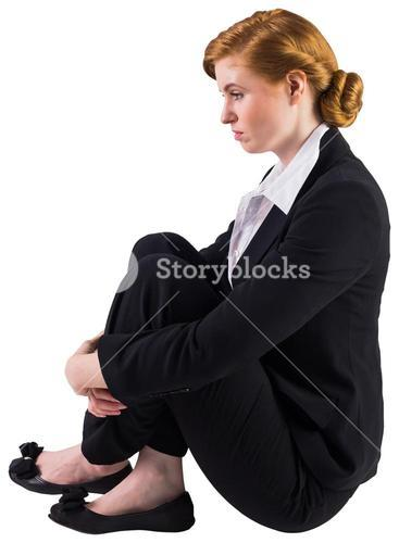 Unhappy redhead businesswoman sitting