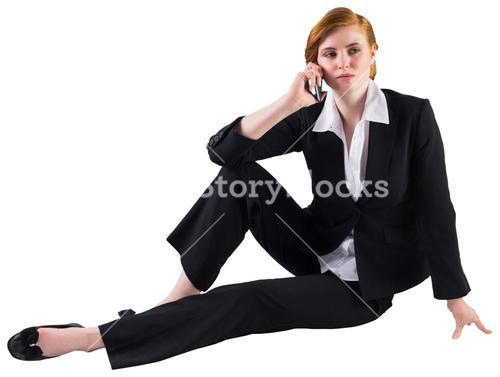Redhead businesswoman on the phone